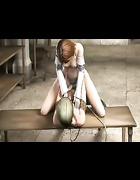 Military dude in a helmet drilling weak girl in bondage on the table